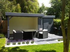 A neat, contemporary garden gazebo with store attached.