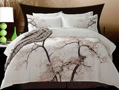 Cotton bedding. The Albany by Alamode is a nature inspired design that is a crisp background with a large tree in deep rich brown with taupe leaves.