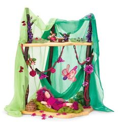 Fairy Forest Home with Accessory Set, 13 Pieces, Autumn by Magic Cabin®. $130.00. For ages 3 and up. Accessories add a homey touch. A magical miniature playhouse. An enchanting retreat for fairies and friends. Elder wood branch frames and pine floors. Save over $15.00! The Fairy forest Home Collection includes our inviting Fairy Forest Home and a seasonal set of Fairy Forest Home Accessories (includes seasonally colored silk gauze, China silk, plant-dyed wool rope ...
