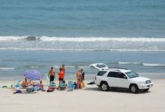 Google Image Result for http://www.twiddy.com/images/family_4x4_beaching.jpg