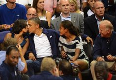 President Obama and First Lady Michelle Obama along with daughter Malia exhibition game Verizon Center July 2012