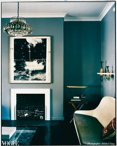 The 1930s chandelier in this living room was in the house when the owner bought it. The painting above the fireplace is an untitled artwork by Anton Hart and the small folding table in the corner is by Axel Osborne.  From 'Art House', a story on page 150 of Vogue Living May/June 2008.  Photograph by Mikkel Vang.