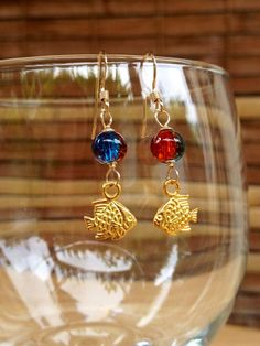 Gold Fish Charm Earrings,Blue Red Glass Beads,Aqua Lava Bead Earrings,Fish Bead Gold Earrings,Nautical Beach Jewelry,Crackle Orange Teal on Etsy, $15.00