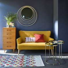 The perfect yellow sofa for living room seating | Mustard yellow 2-seater velvet sofa Leon | Maisons du Monde