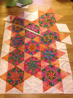 Almost done with my hexagon stack n whack quilt.  Plan to add more negative space for the border and a green border - to add some flower applique.  Giving a modern twist when I free-motion quilt it.  By Dawn