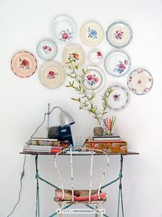 Decorate an empty wall in your home with porcelain plates that have interesting floral patterns on them!