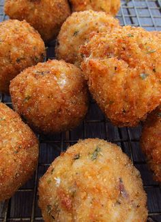 "Arancini Bolognese...Italian for ""little oranges"", these treats are crispy fried risotto balls stuffed with Bolognese sauce and oozy mozzarella."