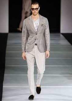 GIORGIO ARMANI  Armani's clothes for next spring and summer are comfortable and relaxed - the kind of clothes the designer himself likes to wear. The white-haired, fit and permanently tanned Armani is known to shun formal wear, preferring slacks and T-shirts to jackets and ties.