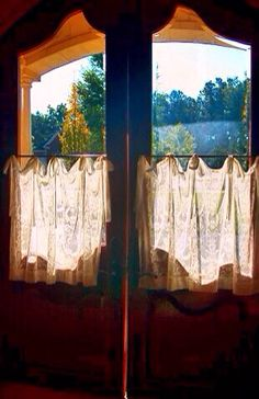 Lace Cafe curtains on a French style house designed by Leo Dowell Interiors.