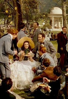 Scarlett O'Hara surrounded by many suitors shortly before the Civil War began