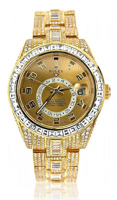 This Custom Fully Iced Out 18K Yellow Gold Diamond Sky Dweller Rolex Watch for Men is featuring 45 carats of baguette and round diamonds masterfully set on 18K gold bracelet and bezel. Its red triangle always points to the time at home, while its conventional hands can be set to a second time zone. The distinctive timepiece for global executives.