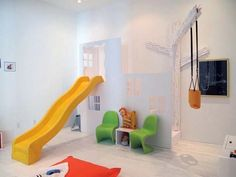 Create a faux fascade to hide the stairs, and then attach a slide--the kids would love this!