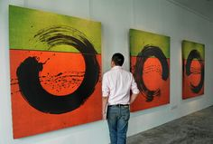 """Paintings by French artist Fabienne Verdier, rooted in the ancient Chinese art of calligraphy entitled """"Ascese N9 2007"""", are exhibited at the Art Plural Gallery during a media preview in Singapore on October 5, 2011."""