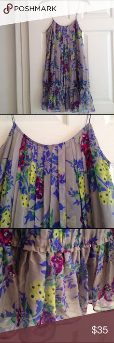 ZARA GREY SILK DRESS WITH FLORAL DESIGN Beautiful pleating on this great grey 100% Silk dress from Zara with floral blooms in a happy mixture of cobalt blue, chartreuse-yellow, burgundy, purple and Spring-green.. So pretty!  And a flirty Elasticized ruffle near the hem.. Fully lined. In Excellent condition. Zara Dresses
