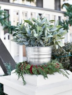 Wreath Turned Plant Stand -While plant saucers are essential for proper drainage, they can sometimes become eyesores. Use an evergreen wreath around the base of a planter to add a touch of holiday style while helping conceal the saucer. HGTV