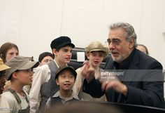 Tenor and Washington National Opera Director Placido Domingo sings and conducts in a Kennedy Center rehearsal room with children from the cast of the company's production of ' Carmen' on November 4, 2008 in Washington, DC. Domingo has announced he will be leaving the Washington National Opera at the end of the 2010-2011 season.