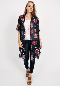 Navy floral printed kimono in sheer fabric, 3/4 sleeves and side splits…