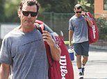 Gavin Rossdale lugs racquet sweaty session tennis club
