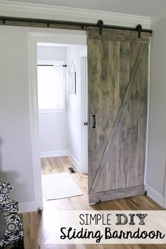 Simple DIY Barn Door Tutorial - ORC week 4 - Noting Grace Simple DIY Barn door tutorial - Jen @ Noting Grace shares how easily it is to switch out a builder grade door with a sliding barn door. Barn Door Baby Gate, Bedroom Barn Door, Wood Barn Door, Diy Barn Door, Barnwood Doors, Wooden Doors, Barn Door Pantry, Barn Door Closet, Double Sliding Barn Doors