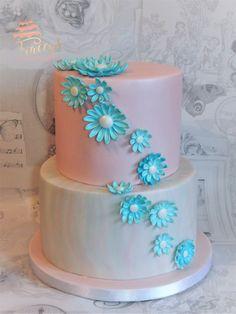 Marbled 2 tier cake with edible daisys