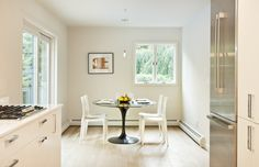 modern on a budget: this kitchen/dining was about an artful composition of shapes and volumes and not about expensive finsihes