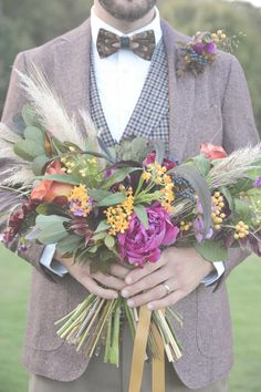 leafy bouquet with wheat, photo by Six Hearts Photography http://ruffledblog.com/fall-wedding-ideas-with-a-floral-and-wheat-bouquet #weddingbouquet #flowers #bouquets
