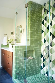 When in doubt, go green 💚 All of these lovely colors are glazed on our Recycled Tile Body. Now that's design for good ♻️🤗 - Design: - Tile shown: Triangles in Kelp, Magnolia, Evergreen, Seedling & and in Kelp - 📷: - Install: - # Mid Century Modern Bathroom, Modern Bathroom Tile, Bathroom Interior, Small Bathroom, Bathroom Green, Master Bathroom, Bathroom Ideas, Bathroom Gallery, Retro Bathrooms