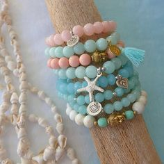 this listing is for one beachcomber aqua mountain jade stretch starfish bracelet. beautiful aqua jade 8mm with a shiny silver starfish charm &