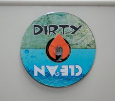 Dirty/ Clean sign for your dishwasher. Adhered with suction cup and made from a CD.