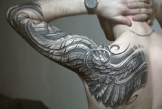 Another anatomically correct wing tattoo