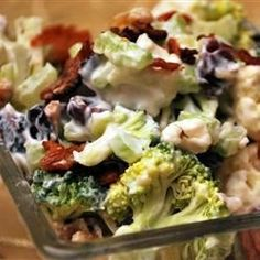 Lots of variety and crunch in this tasty salad.  Spanish peanuts, crumbled bacon, and dried cranberries mingle with fresh broccoli, cauliflower, and celery. The whole shebang is tossed with a mayonnaise, vinegar and oil dressing with a hint of sugar and grated onion.