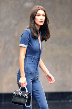 aa5a7be43e6 Bella Hadid goes braless in skintight plunging denim jumpsuit at Victoria s  Secret Fashion Show fitting Bella