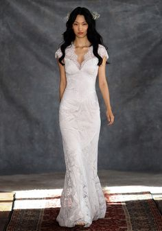 The romantic, scalloped edge vintage lace of our Estelle wedding gown is an instant classic. Sometimes less is more, and this lovely lace V-neck and sheer illus