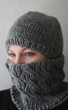 Ravelry: Swampfield Cowl pattern by Sara Amoroso.  Nice cabled cowl pattern.  Free