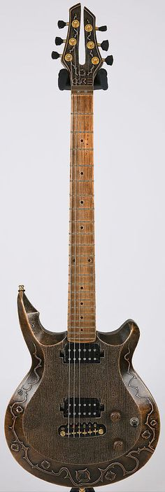 """OGRE Magnox M2 Magnesium Electric Guitar They do say its a """"no wood"""" Guitar, but Magnesium? I'm thinking pure magnesium might be a bit reactive for a guitar body? --- https://www.pinterest.com/lardyfatboy/"""