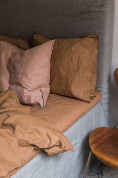 A bedroom with earthy color via Krone Kern