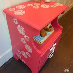 coral pink nightstand with sweeping stenciled flowers angled thumbnail at thehappyhousie