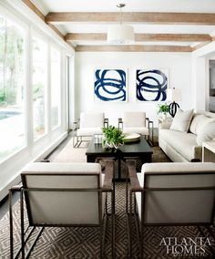 Bernhardt chairs and a sofa from Bungalow Classic make the sunroom an ideal place to gather.