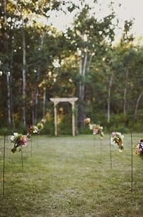 Use flowers and lights to create a simple but gorgeous makeshift aisle. | 32 Totally Ingenious Ideas For An Outdoor Wedding