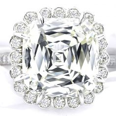 A Crisscut cushion-cut diamond center stone surrounded by round diamonds and set in platinum from Christopher Designs.