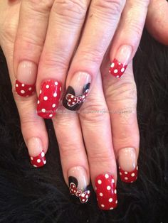 Minnie Mouse Disney nail art with red and white polka dots and black Mickey ears freehand nail art