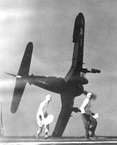 A Vought F4U-4 Corsair of Marine Attack Squadron VMA-322 going into the drink in 1949 after a fouled-up landing attempt on the U.S. escort carrier USS Sicily.