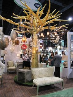 Loving the tree. I would hang eclectic vintage light fixtures from it for sale