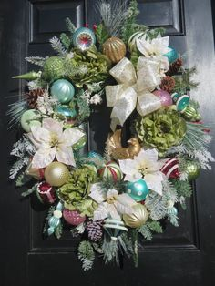 A Raz antiqued gold resin dove is the focal point of this elegant, luxury, Christmas wreath. The Christmas dove is sitting among 24 shatterproof