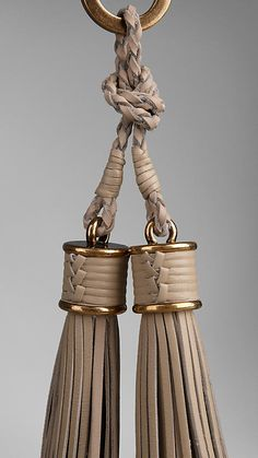 Burberry: Vintage-finish metal key charm with leather tassels