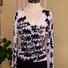 Black & White Sweater This is a comfortable and stylish pullover sweater by Items. Tag says size XL but seems to fit med/lg better. Coordinating fabric appliqués are sewn on front. Herringbone print design in black and gray on white background. Items Sweaters V-Necks