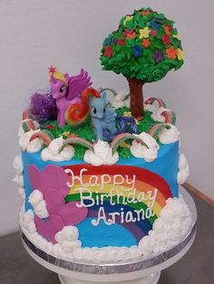 Sweets By Design - San Jose, CA, United States. My Little Pony birthday cake with blue buttercream, gumpaste tree and rainbow candy and cloud top border.