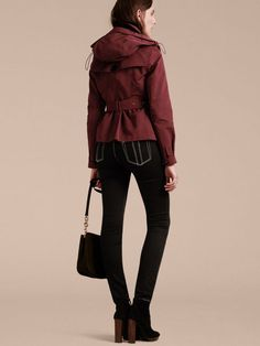 A Burberry hooded taffeta trench jacket prepped for wind and rain and featuring a detachable hood. In smooth, crease-resistant fabric, it's perfect for travelling and has roomy flap pockets.