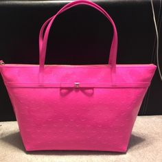Feeling pretty in Pink?! Brand new with tags Kate spade monogrammed bag with gold and pink lining. kate spade Bags Totes