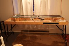 Ski tuning table with skis with bases up